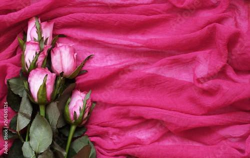 Pink rose flowers on textile © Ortis