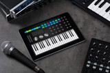 Piano synthesizer app on tablet and musical instrument concept