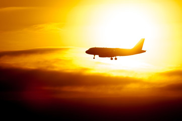 Passenger Aircraft Silhouette With Sun Shining Behind