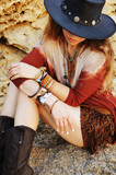Yound beautiful woman fashion portrait, indie hippie style, stones backdrop
