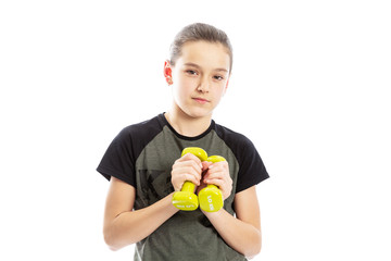 Serious teen girl with dumbbells in their hands. Isolated on a white background. © Анна Демидова