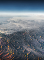 Aerial View from an Airplane. Flying above Beautiful Land at Sunrise. © kaycco
