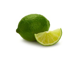 Close up green lime and cut slice over white