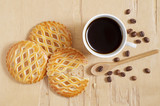 Lattice topped pastries with an apple filling and coffee
