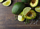 Avocado with lime on a wooden table.