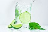 Coctail with lime and fresh mint on white background.